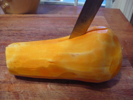 Cut the butternut squash in half